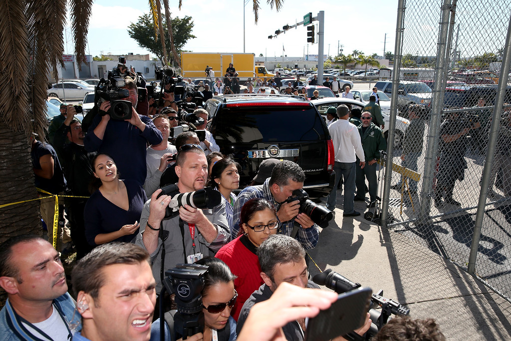 . Media wait for Justin Bieber to exit from the Turner Guilford Knight Correctional Center on January 23, 2014 in Miami, Florida. Justin Bieber was charged with drunken driving, resisting arrest and driving without a valid license after Miami Beach police found the pop star street racing Thursday morning.  (Photo by Joe Raedle/Getty Images)
