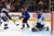 Goalie Jaroslav Halak #41 of the St. Louis Blues makes a save as Barret Jackman #5 of the St. Louis Blues and Jamie McGinn #11 of the Colorado Avalanche follow the play at the Pepsi Center on February 20, 2013 in Denver, Colorado.  (Photo by Doug Pensinger/Getty Images)