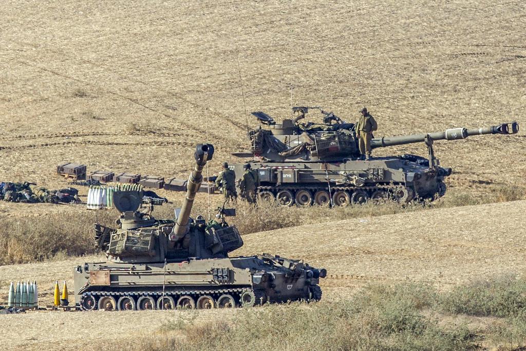 Description of . Israeli soldiers prepare 155mm artillery canons at an army deployment area near Israel's border with the Gaza Strip, on July 16, 2014. New Israeli air and tank strikes in Gaza killed several people, medics said, bringing the death toll from Israel's operation in the besieged Palestinian territory to 208. Since the latest violence began before dawn on July 8, 990 rockets fired from Gaza have struck Israel, and another 244 have been shot down by the Iron Dome anti-missile system, army figures show.  AFP PHOTO / JACK GUEZ/AFP/Getty Images