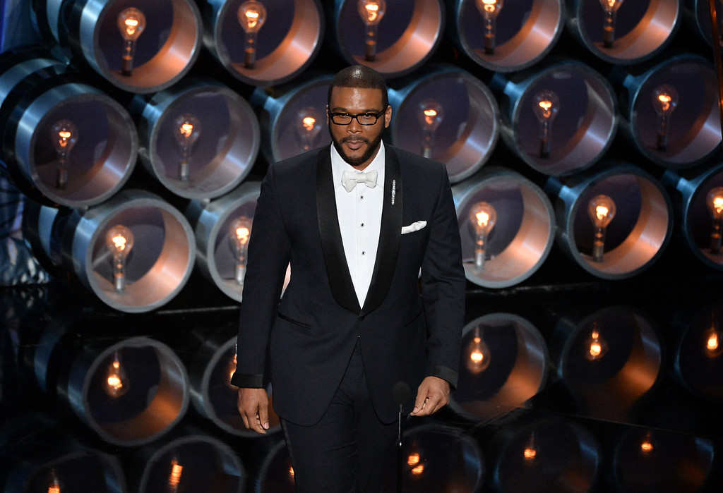 Description of . Actor/director Tyler Perry speaks onstage during the Oscars at the Dolby Theatre on March 2, 2014 in Hollywood, California.  (Photo by Kevin Winter/Getty Images)