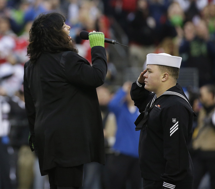 . Singer Ann Wilson sings the National Anthem before the NFL football NFC Championship game between the Seattle Seahawks and the San Francisco 49ers  Sunday, Jan. 19, 2014, in Seattle. (AP Photo/Ted S. Warren)