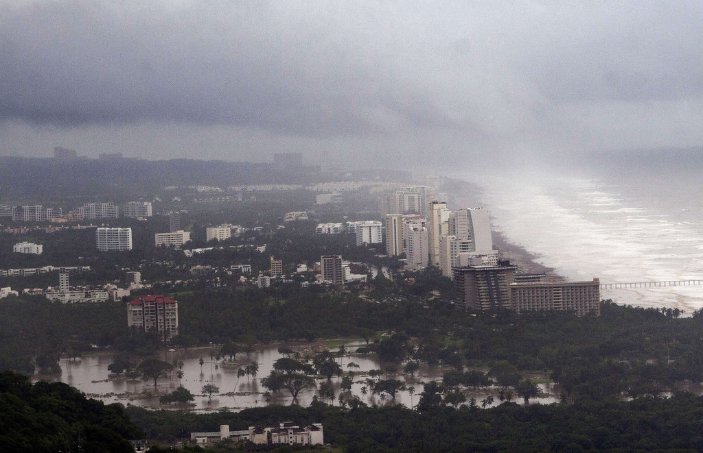 Description of . View of the flooded area in Acapulco, Guerrero state, Mexico, after heavy rains hit the area on September 16, 2013. Hurricane Ingrid weakened to tropical storm strength as it made landfall on the northeastern coast in the morning while the Pacific coast was reeling from the remnants of Tropical Storm Manuel, which dissipated after striking on the eve. Thousands of people were evacuated on both sides of the country as the two storms set off landslides and floods that damaged bridges, roads and homes.   Pedro PARDO/AFP/Getty Images