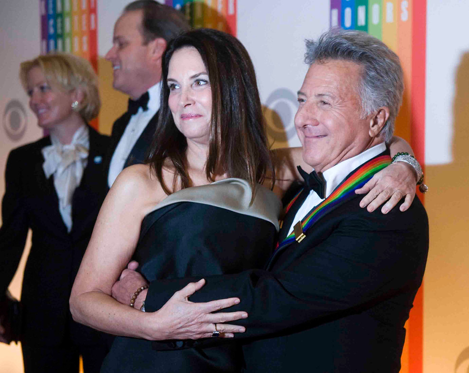 Description of . Kennedy Center Honoree Dustin Hoffman arrives with his wife, Lisa, at the Kennedy Center for the Performing Arts for the 2012 Kennedy Center Honors Performance and Gala Sunday, Dec. 2, 2012 at the State Department in Washington. (AP Photo/Kevin Wolf)