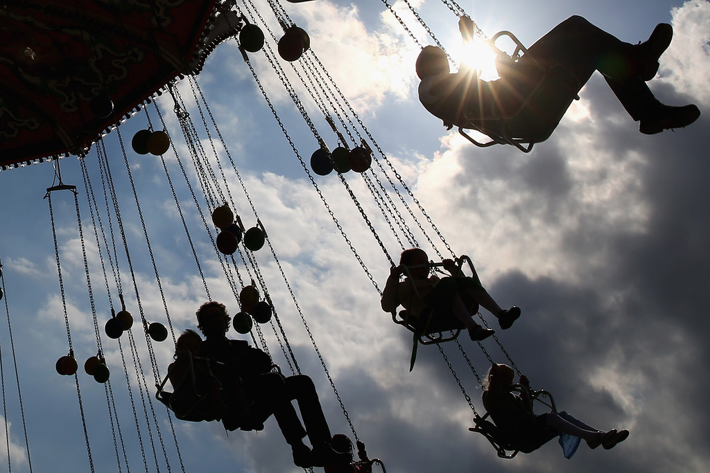 Description of . People enjoy riding on a merry-go-round at the Oktoberfest on September 21, 2013 in Munich, Germany. The Munich Oktoberfest, which this year will run from September 21 through October 6, is the world's largest beer fest and draws millions of visitors.  (Photo by Alexander Hassenstein/Getty Images)