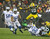 Green Bay Packers' Randall Cobb leaps over Detroit Lions' Don Carey (32) as he runs back a kick during the first half of an NFL football game Sunday, Dec. 9, 2012, in Green Bay, Wis. (AP Photo/Jeffrey Phelps)