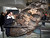 Museum goers touch the Willamette Meteorite during the opening of the Rose Center for Earth and Space Saturday, Feb. 19, 2000, at New York's American Museum of Natural History. An Oregon tribe of Native Americans has submitted a claim to the museum requesting to have the meteorite they call 