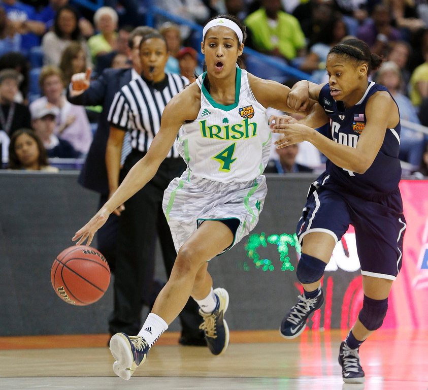 Description of . Notre Dame guard Skylar Diggins (4) drives against Connecticut guard Moriah Jefferson (4) in the first half of the women\'s NCAA Final Four college basketball tournament semifinal, Sunday, April 7, 2013, in New Orleans. (AP Photo/Dave Martin)