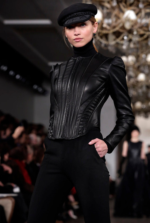 Description of . The Ralph Lauren Fall 2013 collection is modeled during Fashion Week in New York,  Thursday, Feb. 14, 2013. (AP Photo/Richard Drew)