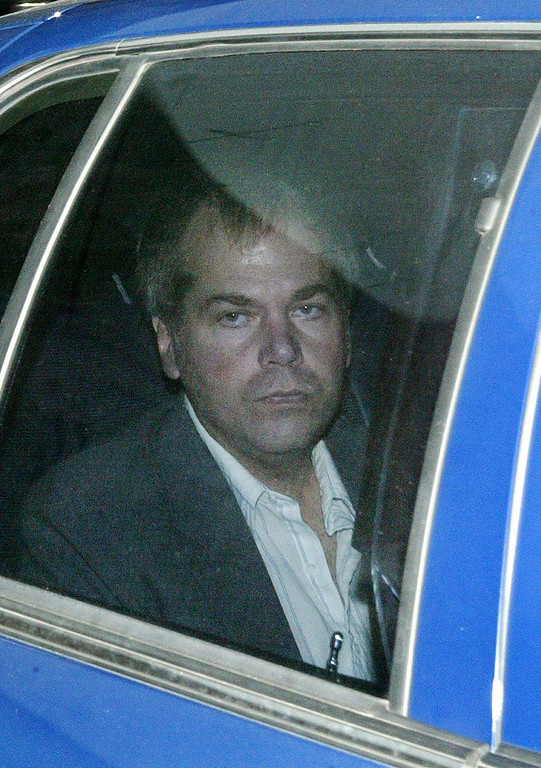 Description of . In a Nov. 18, 2003 file photo, John Hinckley Jr. arrives at U.S. District Court in Washington. Hinckley shot President Ronald Reagan in 1981 in an attempt to impress Oscar-winning actress Jodie Foster, who he had been writing poems and letters to in an attempt to establish a relationship. He was ruled legally insane at the time of the shooting and was sent to a state mental hospital.  (AP Photo/Evan Vucci, File)