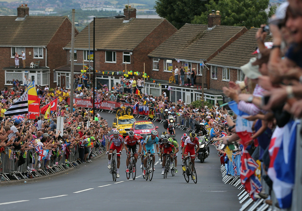 Description of . SHEFFIELD, ENGLAND - JULY 06:  Riders make the climb of the Cote de Kenkins Road to the excitement of the fans during stage two of the 2014 Le Tour de France from York to Sheffield on July 6, 2014 in Sheffield, United Kingdom.  (Photo by Doug Pensinger/Getty Images)