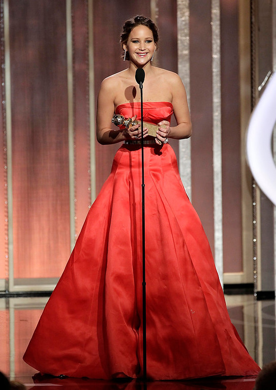 Description of . This image released by NBC shows actress Jennifer Lawrence with her award for best actress in a motion picture comedy or musical for her role in