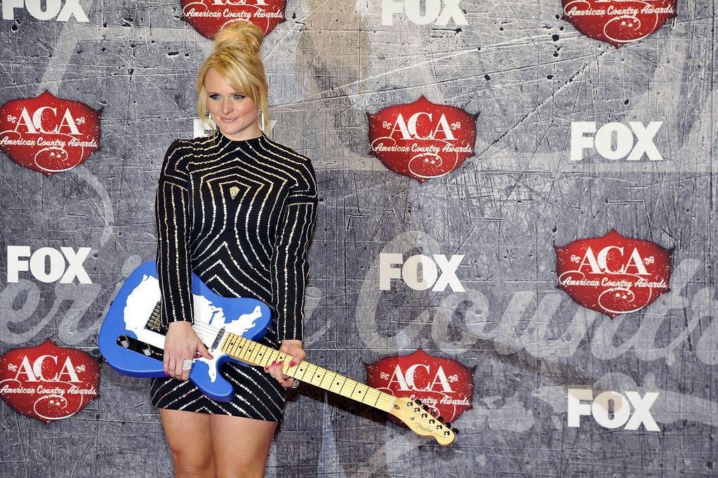 Description of . Recording artist Miranda Lambert poses in the press room with her award for Female Single of the Year backstage at the American Country Awards on Monday, Dec. 10, 2012, in Las Vegas. (Photo by Jeff Bottari/Invision/AP)