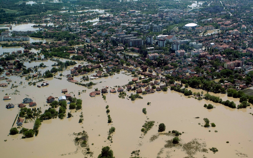 Description of . A flooded area is seen in Obrenovac, some 30 kilometers (18 miles) southwest of Belgrade, Serbia, Monday, May 19, 2014. Belgrade braced for a river surge Monday that threatened to inundate Serbia's main power plant and cause major power cuts in the crisis-stricken country as the Balkans struggle with the consequences of the worst flooding in southeastern Europe in more than a century.  (AP Photo)