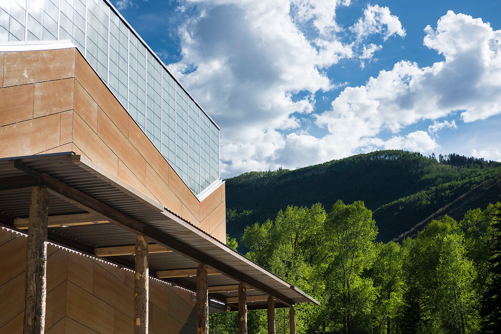 Description of . The Aspen Music School renovation was designed by architect Harry Teague. The roof lines mirror the jagged mountains in the background,  Photo by Alex Irvin. Provided by Aspen Music School.