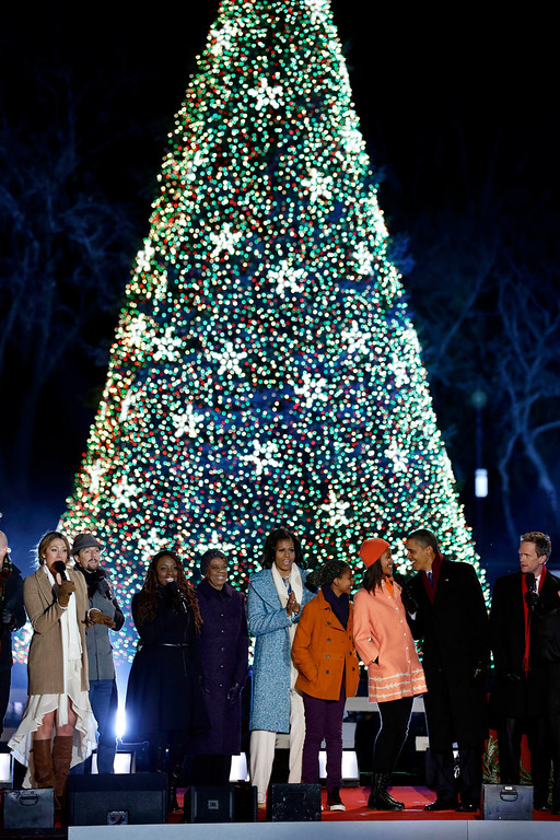 Description of . President Barack Obama, second from right, first lady Michelle Obama, center, Sasha Obama, Malia Obama and Michelle Obama's mother Marian Robinson, left of center, and others participate in the 90th annual National Christmas Tree Lighting ceremony on the Ellipse south of the White House, Thursday, Dec. 6, 2012 in Washington. (AP Photo/Alex Brandon)