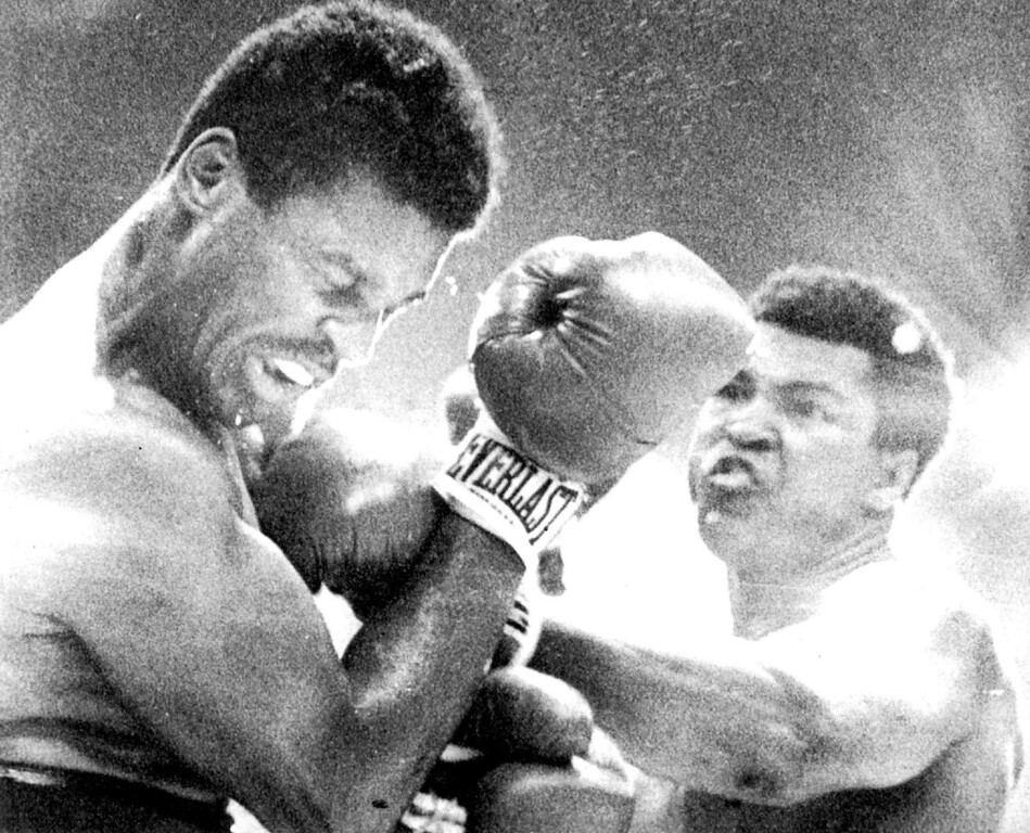 Description of . Ali Connects--Heavyweight Champion Muhammad Ali connects with a left to the face of Jimmy Young during their championship bout at Landover Friday. Ali won a unanimous decision in fifteen rounds. 1976. Credit: AP Wirephoto