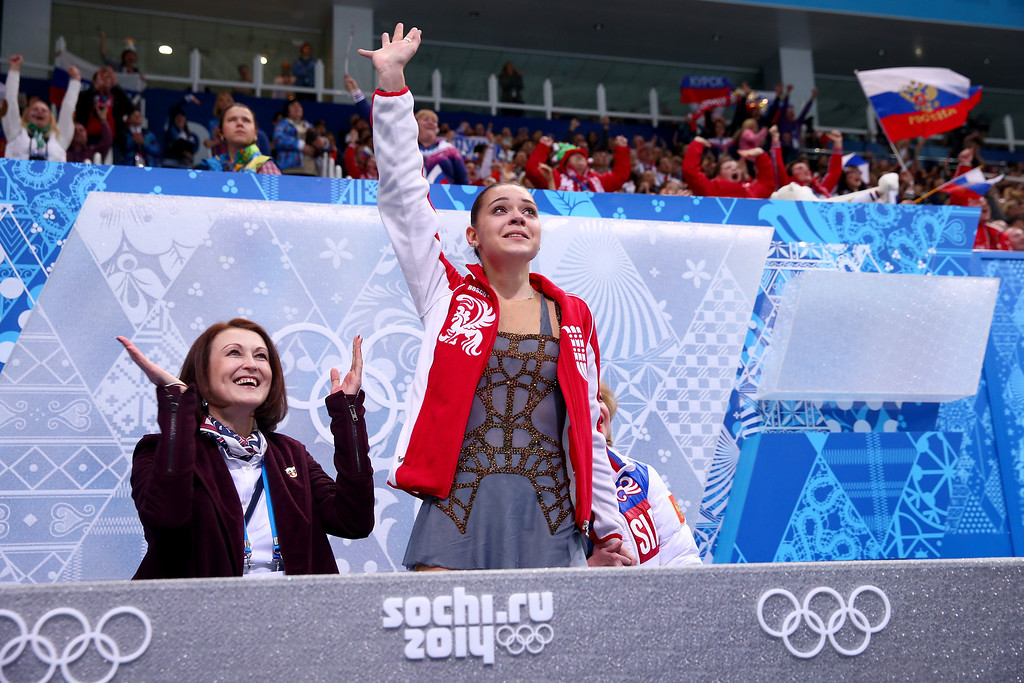Description of . SOCHI, RUSSIA - FEBRUARY 20:  Adelina Sotnikova of Russia waves to fans after her socre announced in the Figure Skating Ladies' Free Skating on day 13 of the Sochi 2014 Winter Olympics at Iceberg Skating Palace on February 20, 2014 in Sochi, Russia.  (Photo by Ryan Pierse/Getty Images)