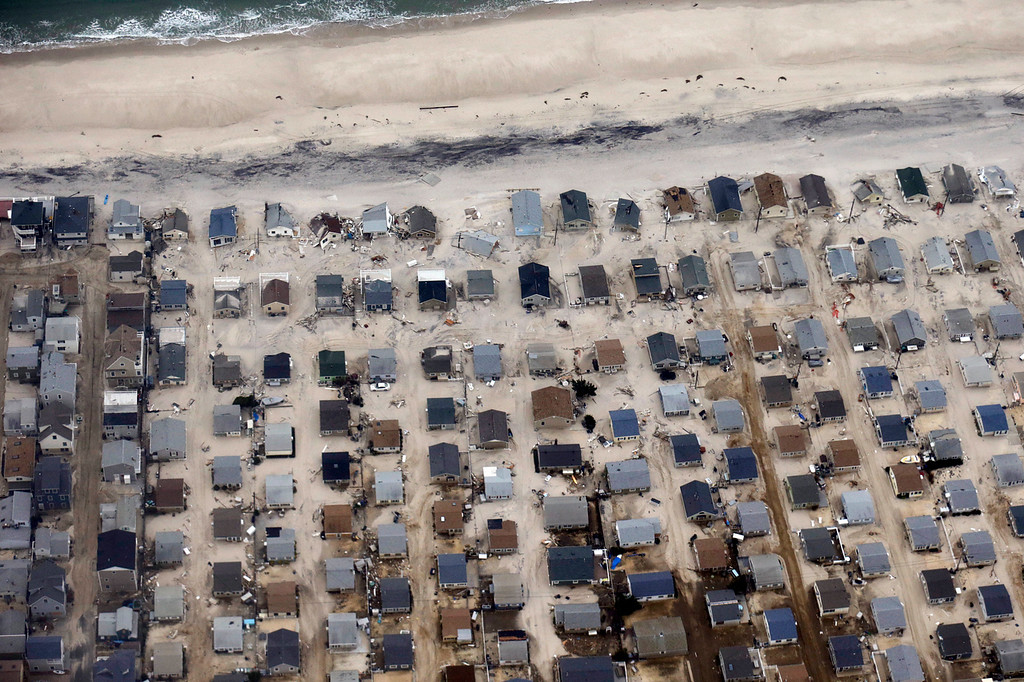 Description of . In this aerial photo, sand covers the roads where several homes were destroyed or severely damaged by Superstorm Sandy in an area of Seaside Heights, N.J., Thursday, Nov. 1, 2012. The photo was taken during a flight to document coastal changes by the National Oceanic and Atmospheric Administration after the storm moved through the area. (AP Photo/Alex Brandon)
