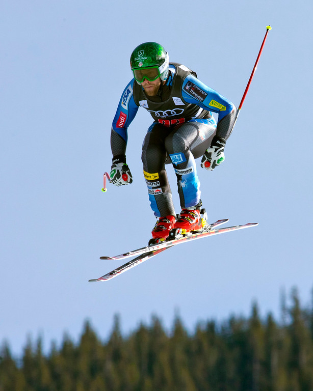 Description of . Travis Ganong, of the United States,is airborne as he speeds down the course during the men's World Cup downhill ski race in Beaver Creek, Colo., on Friday, Nov. 30, 2012. (AP Photo/Nathan Bilow)