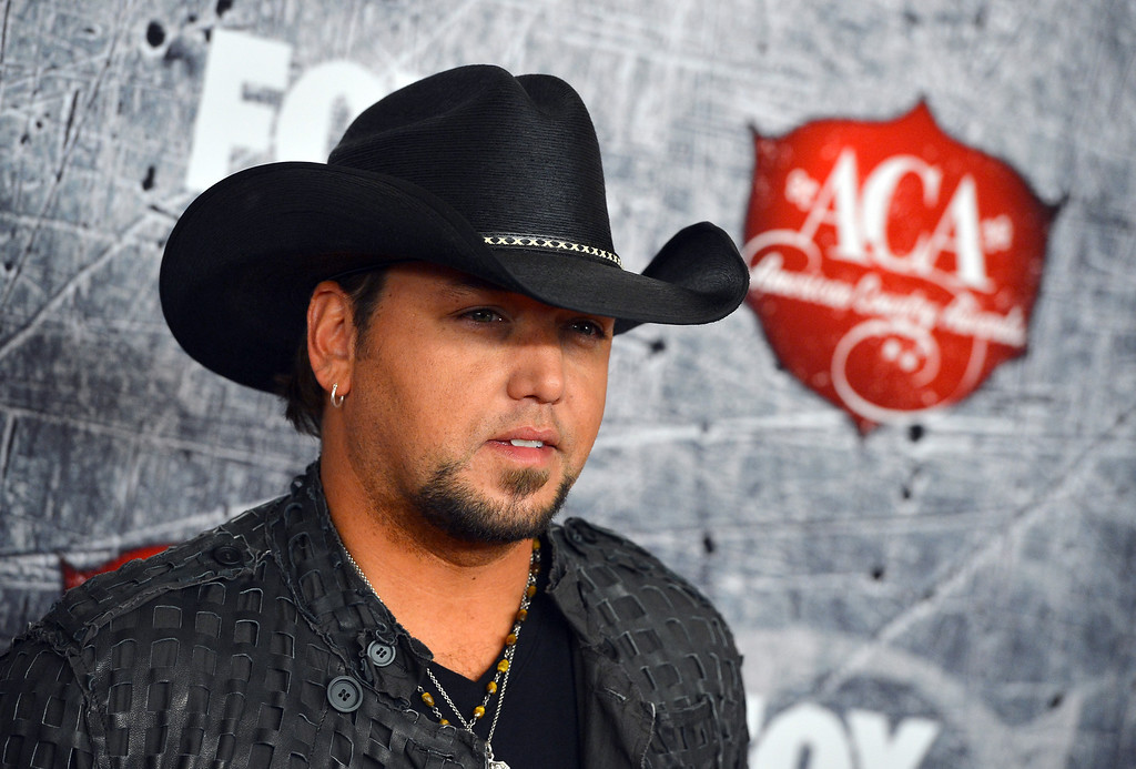 Description of . LAS VEGAS, NV - DECEMBER 10:  Singer Jason Aldean arrives at the 2012 American Country Awards at the Mandalay Bay Events Center on December 10, 2012 in Las Vegas, Nevada.  (Photo by Frazer Harrison/Getty Images)
