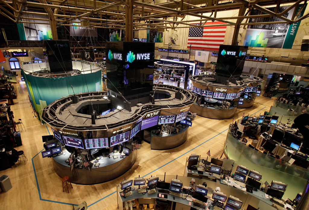 Description of . In this Oct. 29, 2012 file photo, the floor of the New York Stock Exchange is empty of traders in New York. All major U.S. stock and options exchanges remained closed with Hurricane Sandy nearing landfall on the East Coast. Trading has rarely stopped for weather. A blizzard led to a late start and an early close on Jan. 8, 1996, according to the exchange's parent company, NYSE Euronext. The NYSE shut down on Sept. 27, 1985 for Hurricane Gloria. (AP Photo/Richard Drew, File)