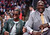 Kevin Hart, left, laughs with Shaquille O'Neal during the first half of the NBA All-Star basketball game Sunday, Feb. 17, 2013, in Houston. (AP Photo/Eric Gay)