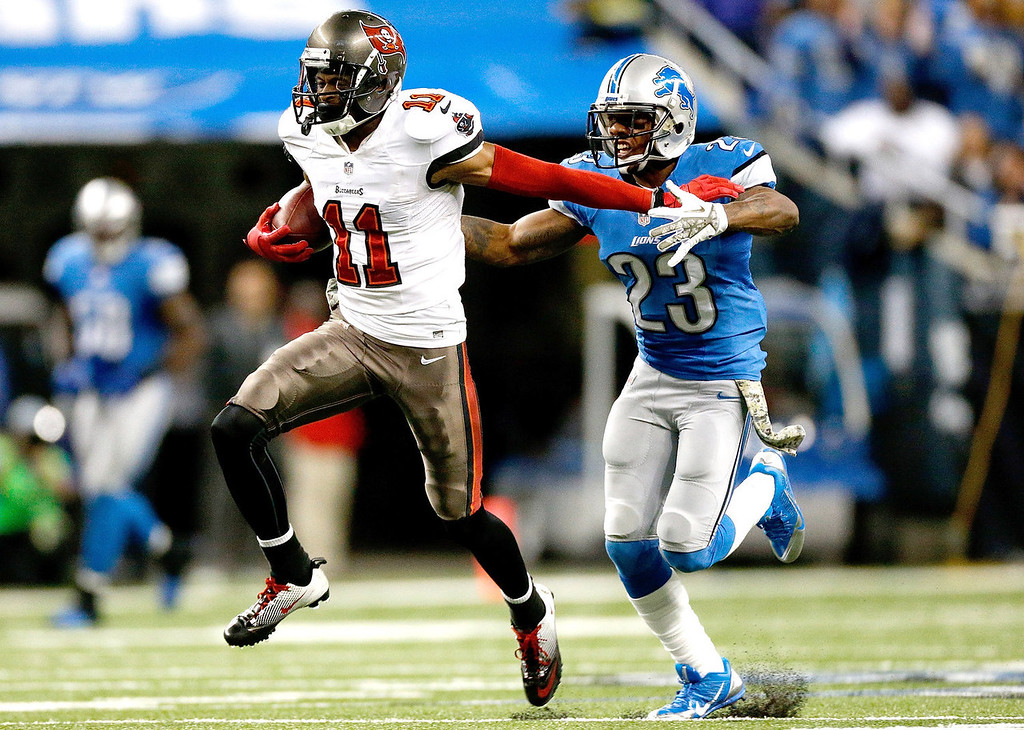 Description of . Tiquan Underwood #11 of the Tampa Bay Buccaneers catches a touchdown pass in front of Chris Houston #23 of the Detroit Lions in the fourth quarter at Ford Field on November 24, 2013 in Detroit, Michigan. (Photo by Gregory Shamus/Getty Images)