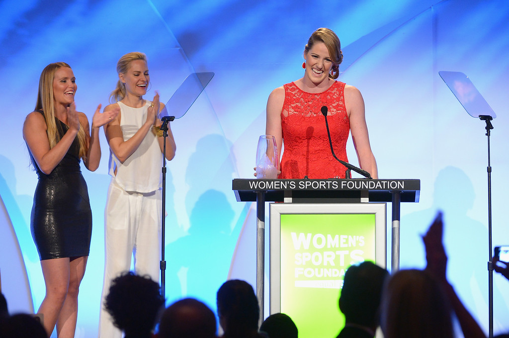 Description of . (L-R) Grete Eliassen and Aimee Mullins present Olympic gold medalist Missy Franklin with the Individual Sports Woman of the Year Award onstage during the 34th annual Salute to Women In Sports Awards at Cipriani, Wall Street on October 16, 2013 in New York City.  (Photo by Michael Loccisano/Getty Images for the Women's Sports Foundation)