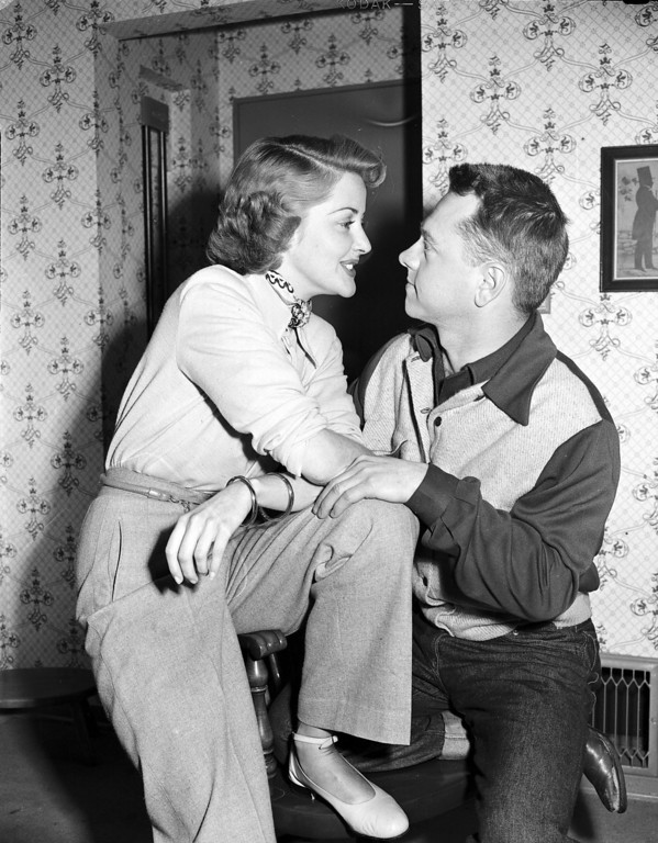 Description of . Actress Martha Vickers and Actor Mickey Rooney cast adoring eyes on each other, at Vicker's home in North Hollywood, Calif., on March 7, 1949. The couple is engaged, however the bride will not be free to wed until late summer when her divorce from publicist A.C. Lyles is final.  (AP Photo)
