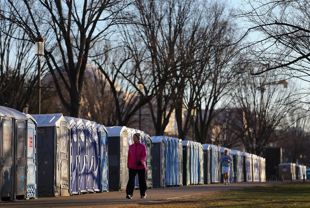Description of . Portable bathrooms line the National Mall as preparations continue for the Presidential Inauguration  on January 20, 2013 in Washington, DC.  The US capital is preparing for the second inauguration of US President Barack Obama, which will take place on January 21.  (Photo by Joe Raedle/Getty Images)