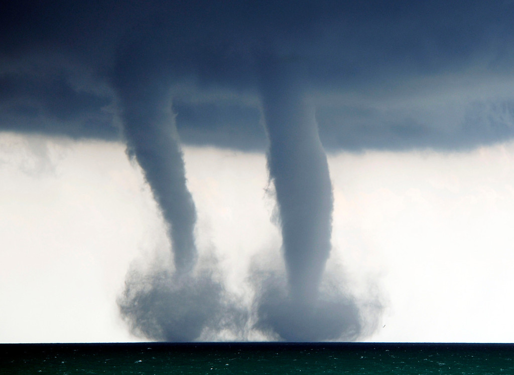 Description of . A pair of water spouts form on Lake Michigan southeast of Kenosha, Wis. on Thursday, Sept. 12, 2013. The National Weather Service in Sullivan said the water spouts occurred about four miles southeast from Kenosha.  (AP Photo/The Kenosha News, Kevin Poirier)