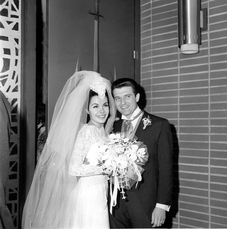 Description of . Newlyweds actress Annette Funicello and her groom, motion picture agent Jack Gilardi, are leaving St. Cyril's Roman Catholic Church in Encino, Calif., on January 9, 1965, following their wedding ceremony.  (AP Photo)