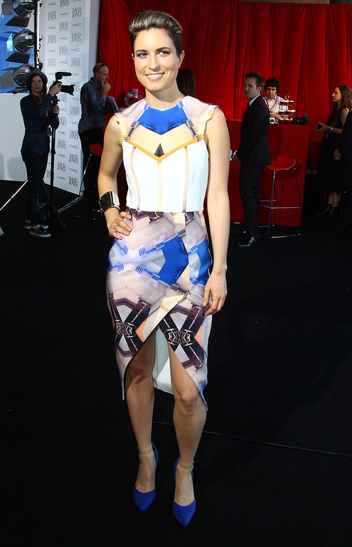 Description of . Australian singer-songwriter Missy Higgins arrives for the Australian music industry Aria Awards in Sydney, Thursday, Nov. 29, 2012. (AP Photo/Rick Rycroft)