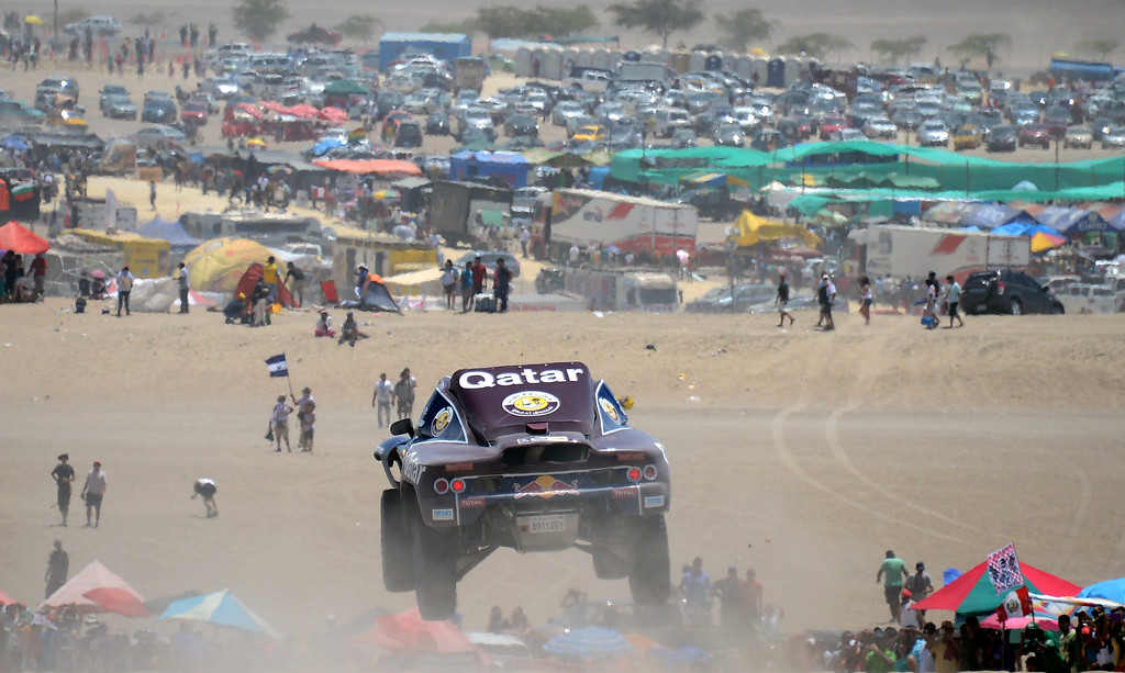 Description of . Qatar's Nasser Al-Attiyah competes during the Stage 2 of the Dakar 2013 between Pisco and Pisco, Peru, on January 6, 2013. The rally will take place in Peru, Argentina and Chile from January 5 to 20.  FRANCK FIFE/AFP/Getty Images