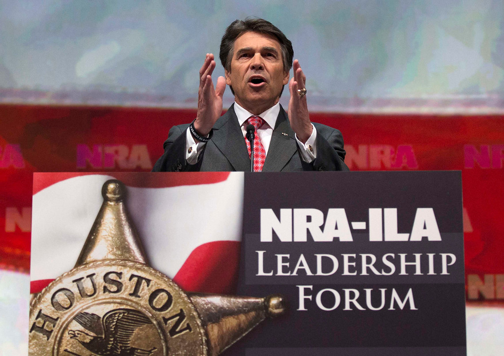 Description of . Texas Governor Rick Perry speaks at the NRA-ILA Leadership Forum at the George R. Brown Convention Center, the site for the National Rifle Association's annual meeting in Houston, Texas on May 3, 2013. It is time to stop demonizing all law-abiding gun owners because of violent acts committed by a few criminals, National Rifle Association leaders and political allies said on Friday at its first convention since the Connecticut school massacre. Organizers expect some 70,000 attendees at the 142nd NRA Annual Meetings & Exhibits in Houston, which began on Friday and continues through Sunday. REUTERS/Adrees Latif (UNITED STATES - Tags: POLITICS)
