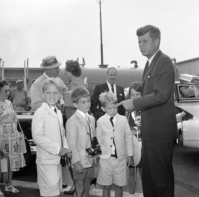 Description of . Sen. Kennedy, Democratic presidential nominee,  talks to three of his nephews just before they boarded a plane in Los Angeles on July 17, 1960, on their way home to Massachusetts. From left are Bobby Shriver, son of Kennedyís sister, Mrs. R. Sargeant Shriver; and Bobby and Joe Kennedy, sons of the senator's brother, Robert Kennedy. Associated Press file