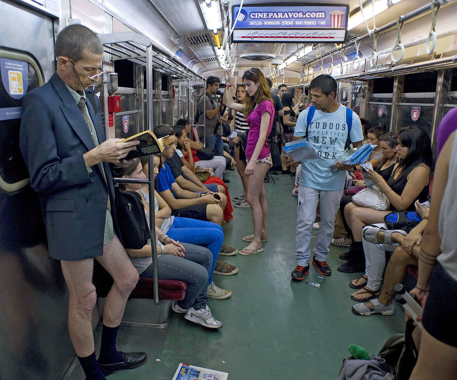 ". People taking part in the ""No Pants Subway Ride\"" remain on a metro train in Buenos Aires on January 12, 2014. \""No Pants Subway Ride\"" is an annual event in which transit passengers ride trains without wearing pants in January. The event is observed in dozens of cities worldwide. ALEJANDRO PAGNI/AFP/Getty Images"