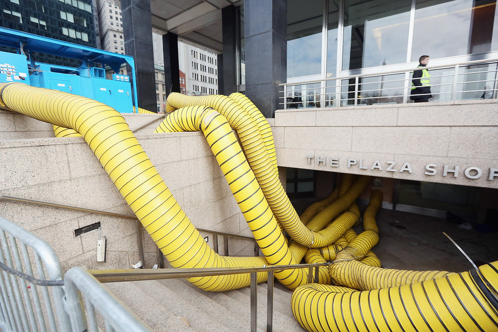 . Tubes carry hot air being pumped into a Financial District building that flooded in an attempt to dry out the building following Superstorm Sandy in lower Manhattan on November 19, 2012 in New York City. Many of the office towers in the low lying Financial District which flooded remain closed due to damage to heating and electrical infrastructure.  Many other buildings in the area are being powered by generators.  (Photo by Mario Tama/Getty Images)
