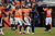 Broncos Defensive Coordinator Jack Del Rio hugs Denver Broncos cornerback Chris Harris (25) after Harris broke up a pass intended for Denver Broncos tight end Joel Dreessen (81) during the first half.  The Denver Broncos vs Baltimore Ravens AFC Divisional playoff game at Sports Authority Field Saturday January 12, 2013. (Photo by John Leyba,/The Denver Post)