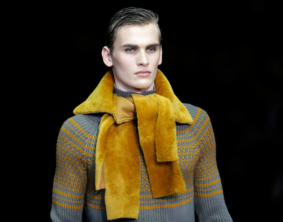 Description of . A model wears a creation for Emporio Armani men's Fall-Winter 2013-14 collection, part of the Milan Fashion Week, unveiled in Milan, Italy, Monday, Jan. 14, 2013. (AP Photo/Antonio Calanni)