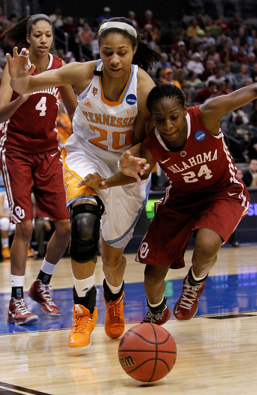 Description of . Tennessee's center Isabelle Harrison (20) and Oklahoma's guard Sharane Campbell (24) go after a loose ball in the second half of their game during the regional semifinal in the women's NCAA college basketball tournament in Oklahoma City Sunday March 31, 2013.  Tennessee won 74-59.   (AP Photo/Alonzo Adams)