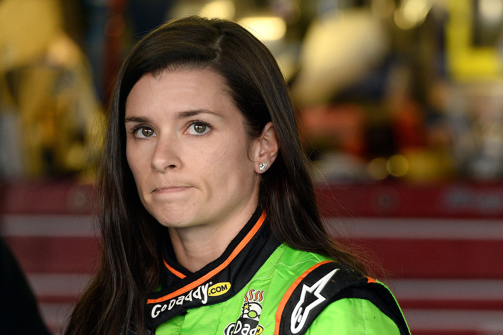 Description of . TALLADEGA, AL - MAY 04:  Danica Patrick, driver of the #34 AccuDoc Solutions / GoDaddy Chevrolet, looks on in the garage after she suffered damage to her car and was knocked out of the race during the NASCAR Nationwide Series Aaron's 312 at Talladega Superspeedway on May 4, 2013 in Talladega, Alabama.  (Photo by Patrick Smith/Getty Images)