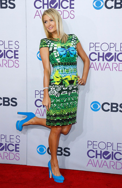 Description of . Socialite Paris Hilton poses as she arrives at the 2013 People's Choice Awards in Los Angeles, January 9, 2013.   REUTERS/Danny Moloshok