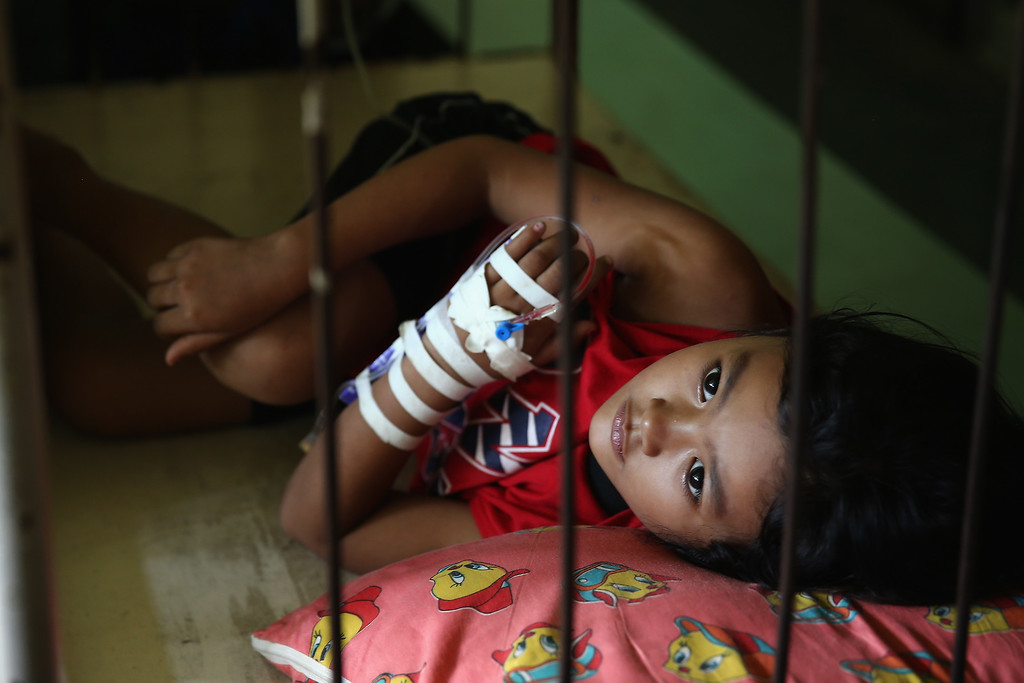 Description of . A young girl lies in a bed awaiting treatment in Tacloban Hospital on November 15, 2013 in Leyte, Philippines.   (Photo by Dan Kitwood/Getty Images)