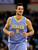 Denver Nuggets small forward Danilo Gallinari, of Italy, smiles as he runs up court after scoring his 39th point of the night against the Dallas Mavericks in the second half of an NBA basketball game on Friday, Dec. 28, 2012, in Dallas. Gallinari finished with 39 in the 106-85 win. (AP Photo/Tony Gutierrez)