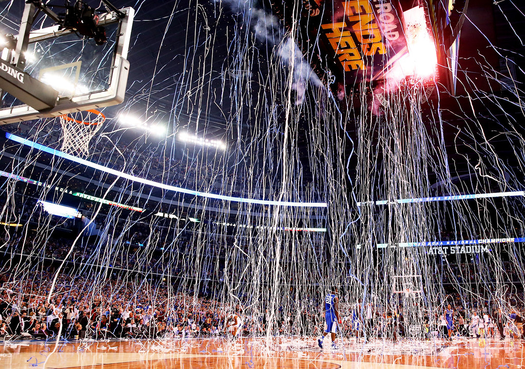 Description of . ARLINGTON, TX - APRIL 07: Confetti falls after the Connecticut Huskies defeated the Kentucky Wildcats 60-54 in the NCAA Men\'s Final Four Championship at AT&T Stadium on April 7, 2014 in Arlington, Texas.  (Photo by Ronald Martinez/Getty Images)
