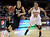 University of Colorado's Arielle Roberson drives past Maiya Michel during a games against the University of Denver on Tuesday, Dec. 11, at the Magnus Arena on the DU campus in Denver.   (Jeremy Papasso/Daily Camera)