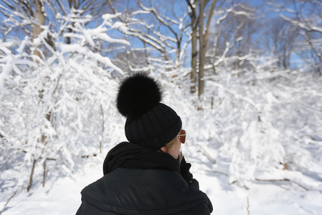 . NEW YORK, NY - FEBRUARY 09:  A woman walks along a snow-covered trail in Central Park on February 9, 2013 in New York City. The park received almost a foot of snow, as New York was spared the worst of the massive snow storm that hit the U.S. Northeast.  (Photo by John Moore/Getty Images)