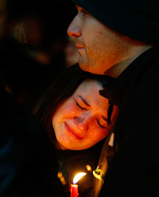 Description of . People mourn the loss of Victoria Soto, the first-grade teacher at Sandy Hook Elementary School who was shot and killed while protecting her students, during a candlelight vigil at Stratford High School on December 15, 2012 in Stratford, Connecticut. Twenty-six people were shot dead, including twenty children, after a gunman identified as Adam Lanza opened fire in the school. Lanza also reportedly had committed suicide at the scene. A 28th person, believed to be Nancy Lanza was found dead in a house in town, was also believed to have been shot by Adam Lanza. (Photo by Jared Wickerham/Getty Images)