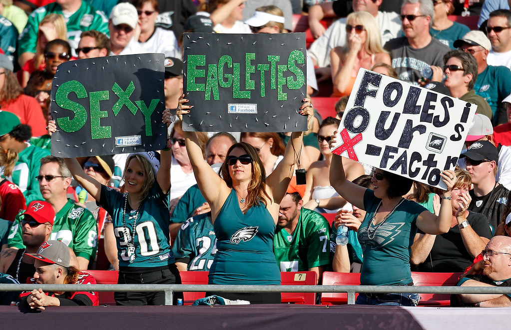 Description of . TAMPA, FL - DECEMBER 09:  Fans of the Philadelphia Eagles celebrate against the Tampa Bay Buccaneers during the game at Raymond James Stadium on December 9, 2012 in Tampa, Florida.  (Photo by J. Meric/Getty Images)